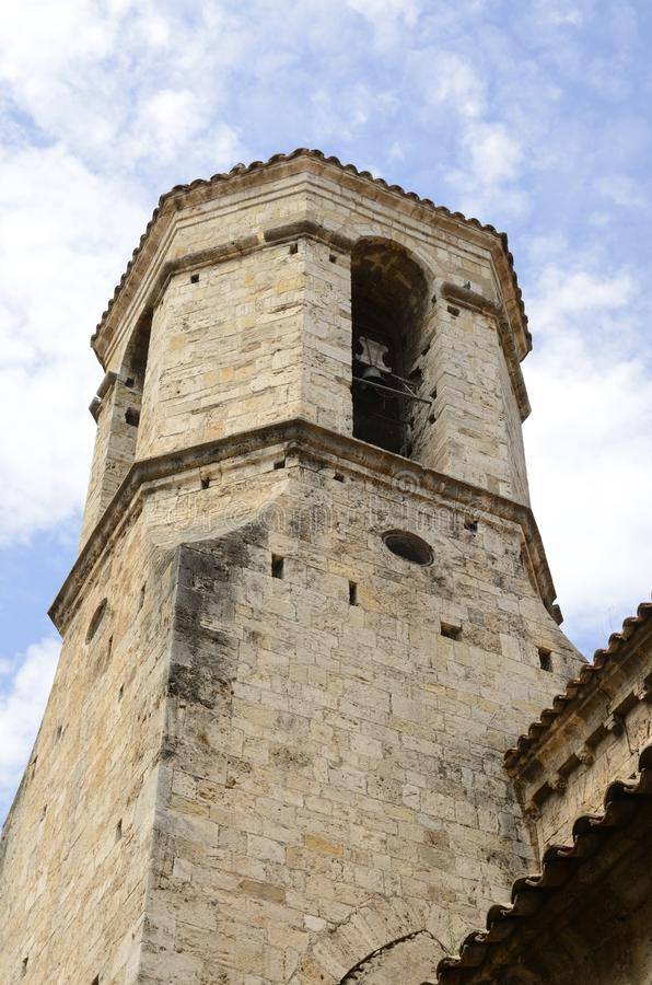 Bell tower in Besalu. Bell Tower of the romanic church of Saint Vicent in Besalu, a town in the comarca of Garrotxa, in Girona, Catalonia, Spain stock photo