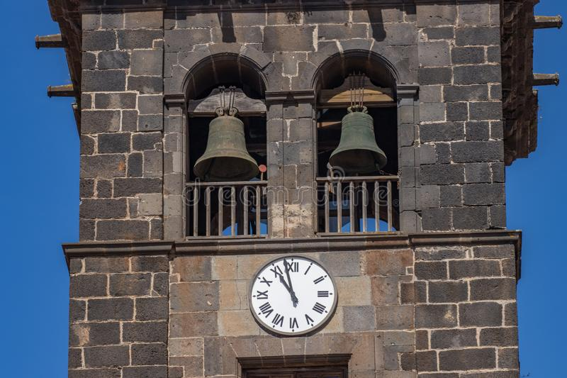 Bell tower with big clock on the wall in Church of the Immaculate Conception, San Cristobal de La Laguna, Tenerife, Spain. stock photography