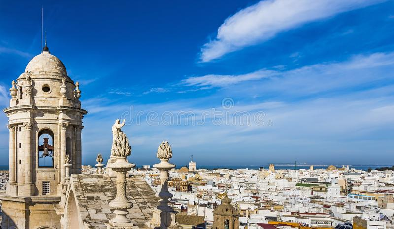 Bell tower of Cadiz Cathedral and aerial view of the western city and Bay of Cadiz royalty free stock image