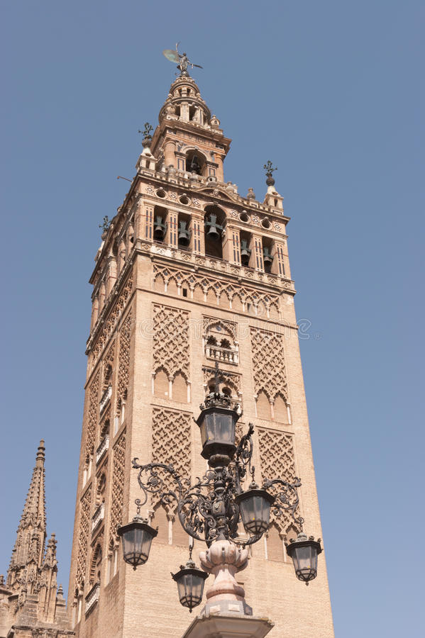 The. Bell tower of  Cadral of Seville, known as  Giralda.  tower was  minaret of  city's mosque. After  conquest of Seville by  Christians  mosque was converted royalty free stock image