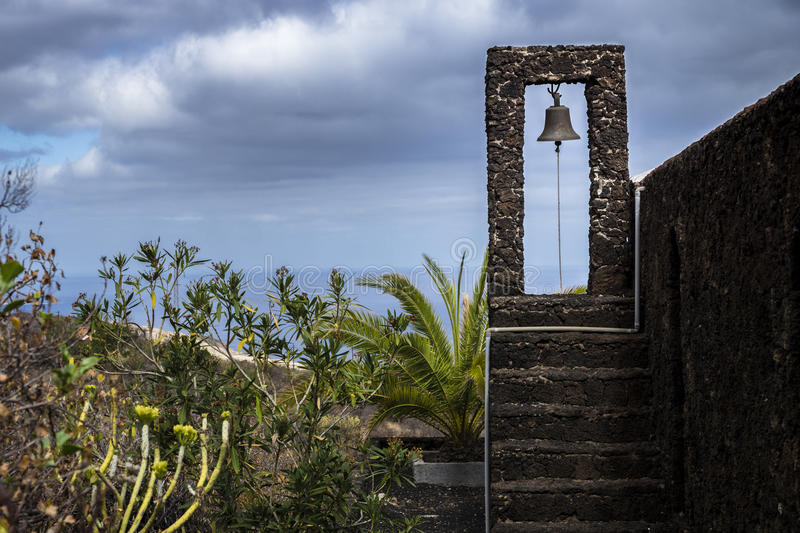 Bell tower of a church in El Golfo Valley El Hierro. Canary Island, Spain stock photography