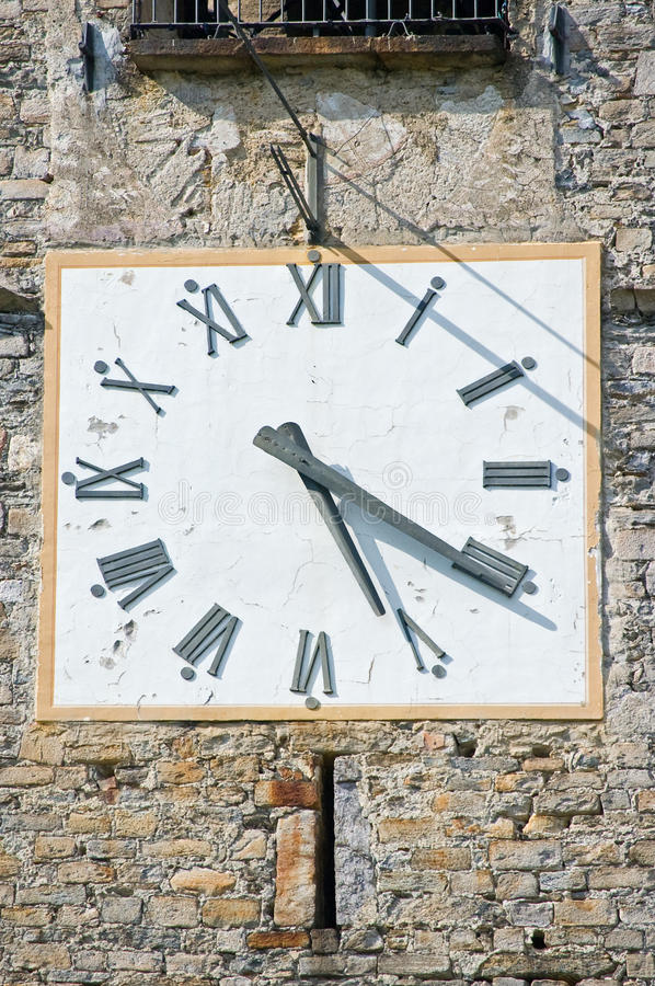 Bell tower clock. Old bell tower clock with roman numerals royalty free stock image