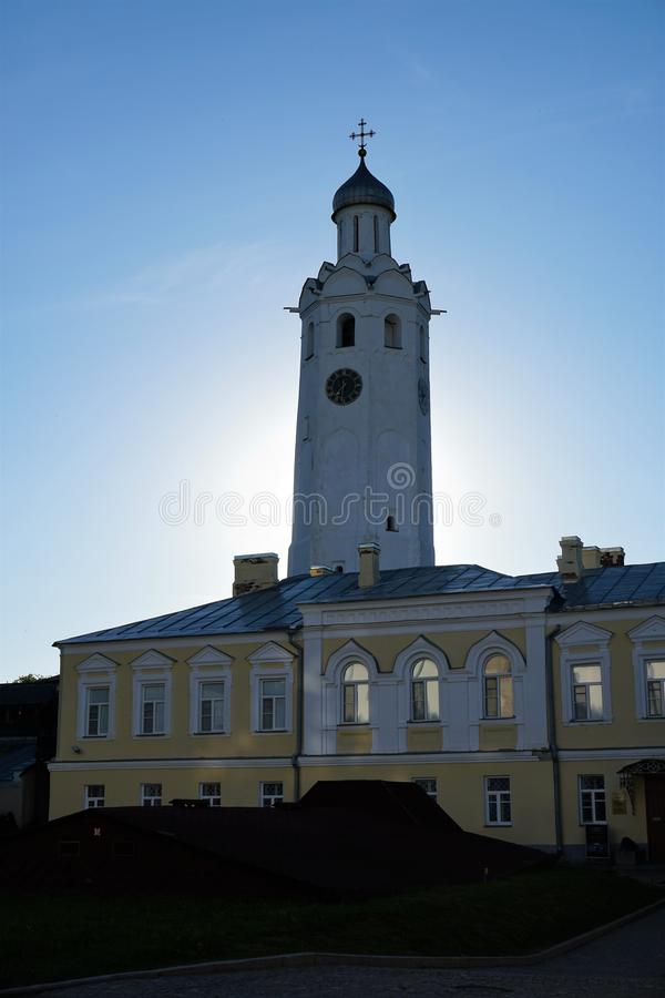 Bell tower with the clock of the Novgorod Kremlin at sunset. royalty free stock photos