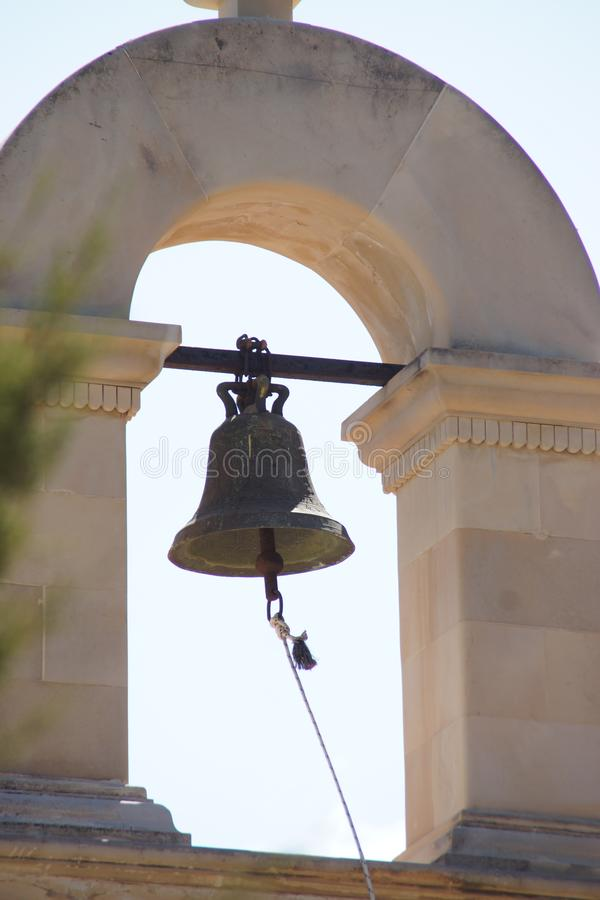 The bell of a bell tower in Crete - Crète. The bell of a bell tower in Crete.- Crète - Europe A bell is a simple object intended for the broadcast emission royalty free stock photos