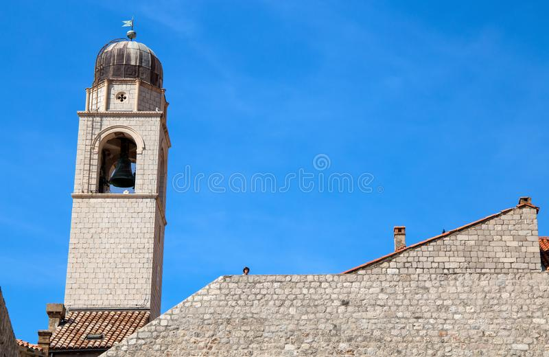The bell tower of the Franciscan monastery in the Old Town of Dubrovnik, Dalmatia, Croatia. Its beauty is listed in the UNESCO Wor. The bell tower of the royalty free stock images