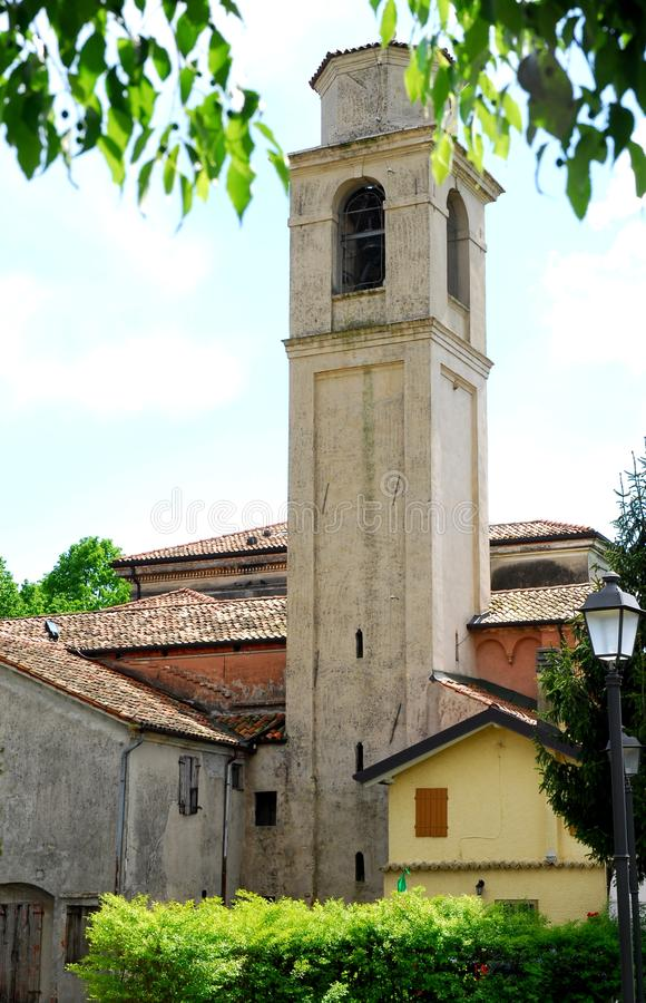 Bell tower and the group of houses in Portobuffolè in the province of Treviso in the Veneto (Italy) royalty free stock photo