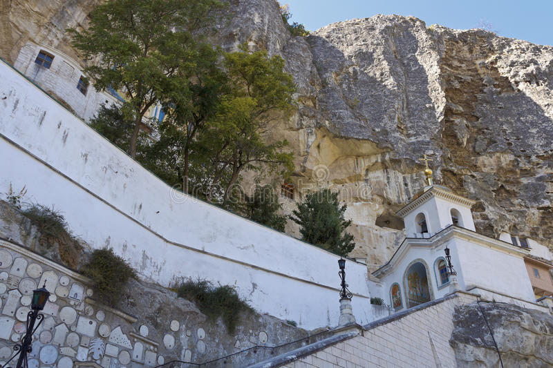 The bell tower of the Holy Dormition cave monastery.Bakhchisarai. Crimea royalty free stock photo