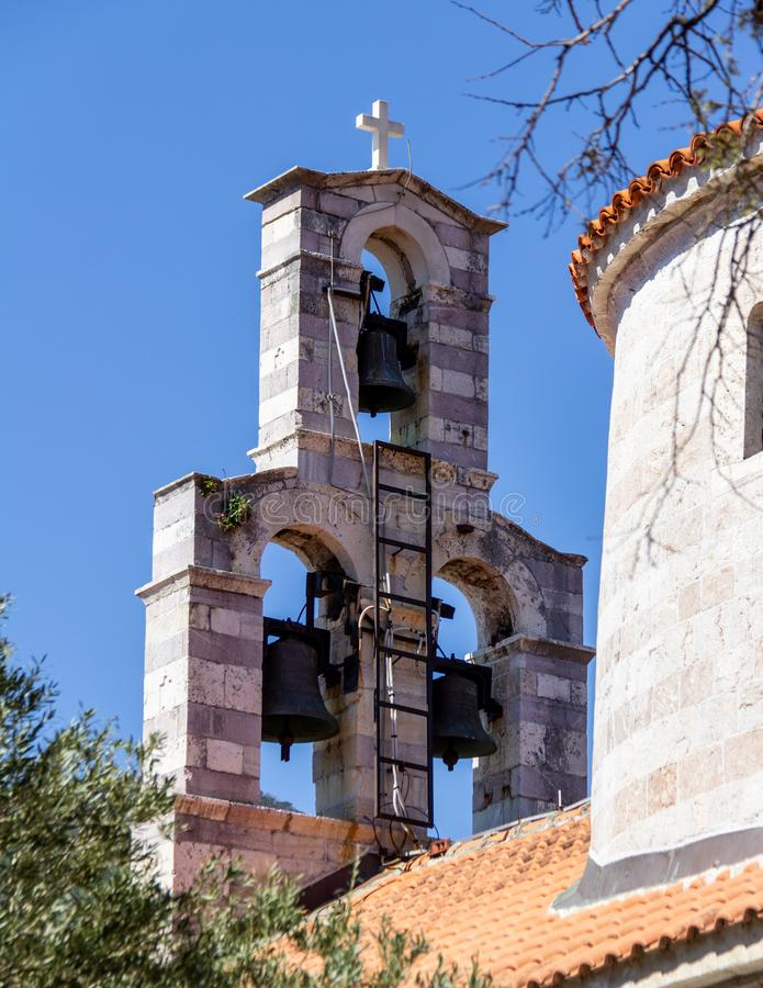 Bell tower of Holy trinity church in Budva, Montenegro royalty free stock images
