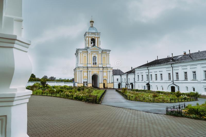 Bell tower of Khutyn Monastery of Saviour`s Transfiguration and. Of St. Varlaam. Russia, Novgorod Veliky. Summer, rainy day stock image