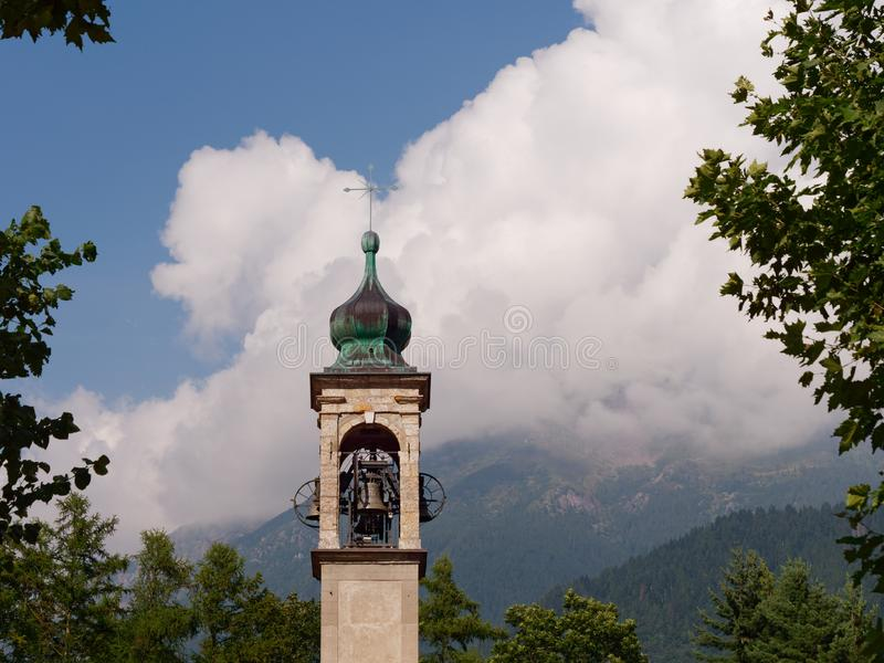 Bell tower of a mountain italian village stock image