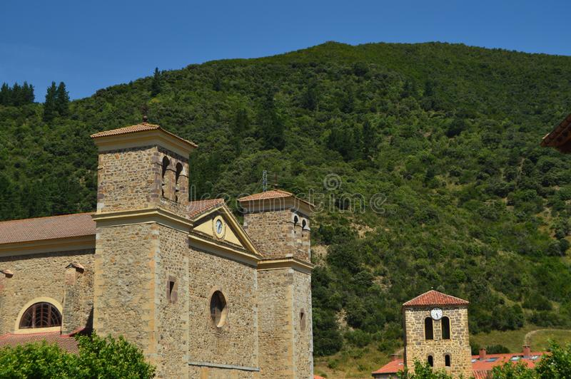 Bell Tower Of The New And Old Church Of San Vicente In Villa De Potes. Nature, Architecture, History, Travel. royalty free stock photo
