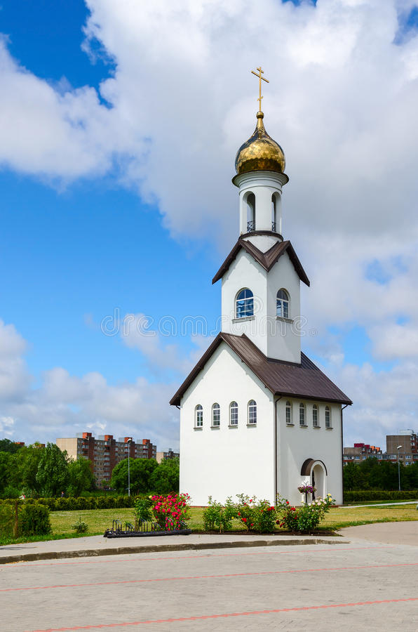 Bell tower of Pokrovo - Nicholas Church, Klaipeda, Lithuania. KLAIPEDA, LITHUANIA - JULY 11, 2015: The bell tower of church in honor of Protection of Mother of royalty free stock images