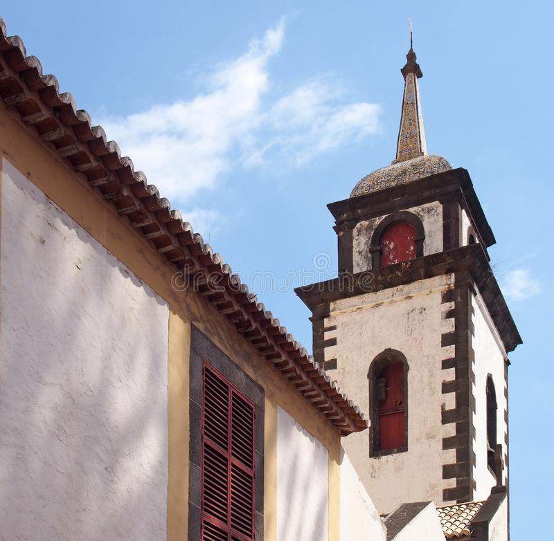 The tower of São Pedro church in funchal a historic 17th century building in madeira notable for the colored tiles on the spire. The bell tower of São royalty free stock images