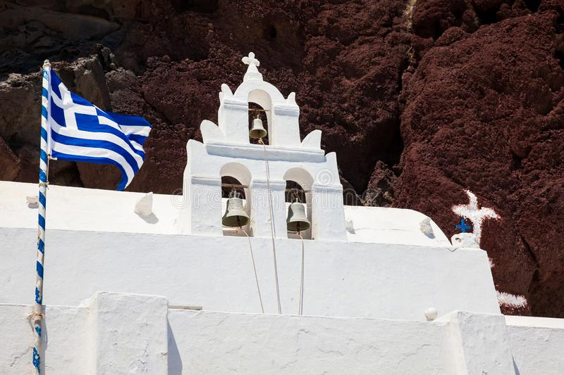 Bell tower of the Saint Nikolaos Orthodox Church located in Akrotiri next to the famous Red Beach at Santorini Island stock images