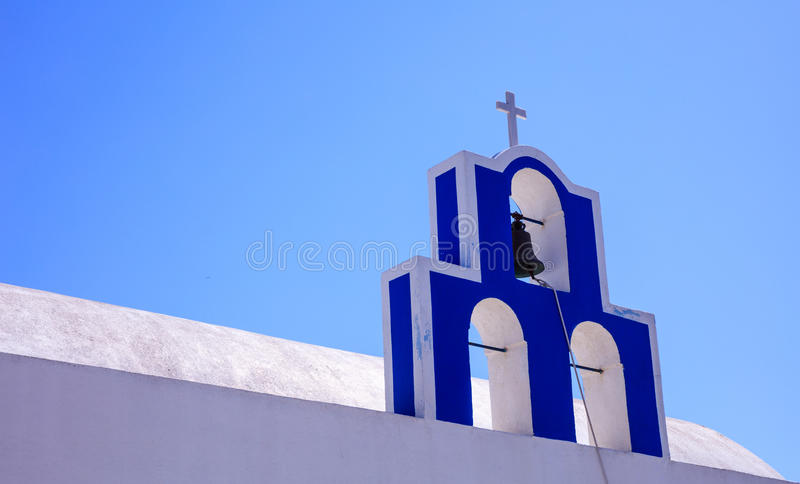 Bell tower in Santorini, Greece. Santorini, Greece - Bell tower on blue sky background royalty free stock photo