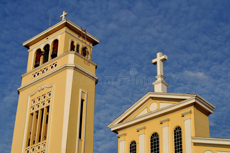 Bell Tower of the Shrine of Our Lady of Manaoag. The bell tower and the front arch of the Shrine of Our Lady of the Most Holy Rosary of Manaoag in Dagupan City stock image