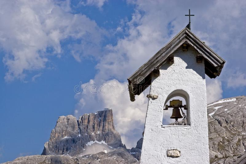 Bell tower of a small mountain chapel royalty free stock photo
