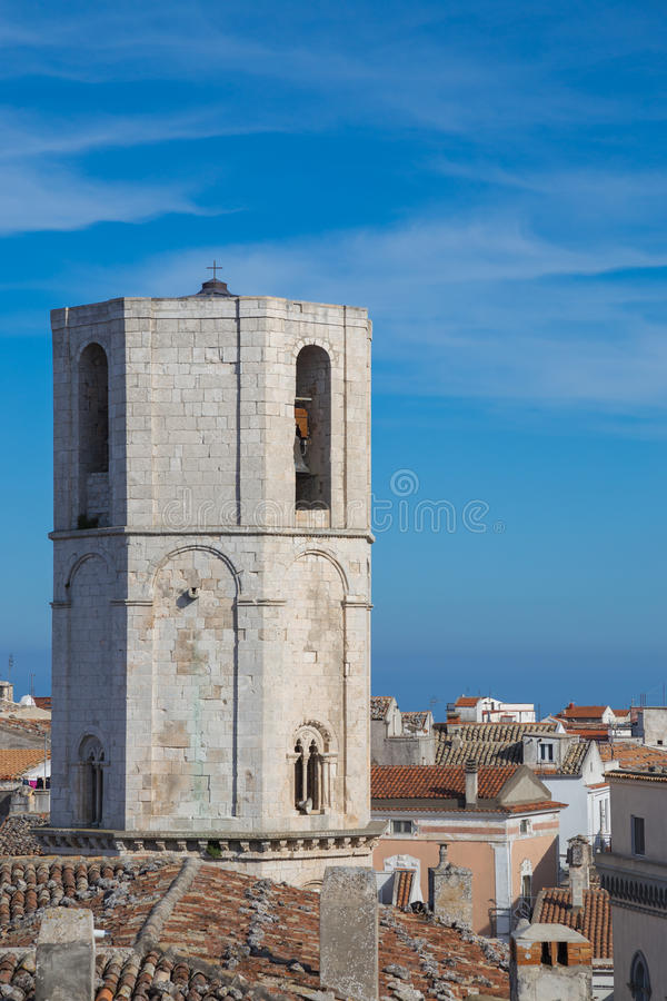 Bell tower of St. Michel. View of the steeple of the church of San Michele in Monte Sant`Angelo royalty free stock photos