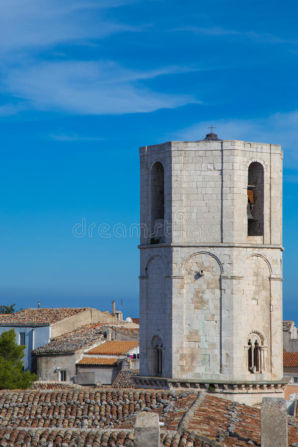 Bell tower of St. Michel. View of the steeple of the church of San Michele in Monte Sant`Angelo royalty free stock image