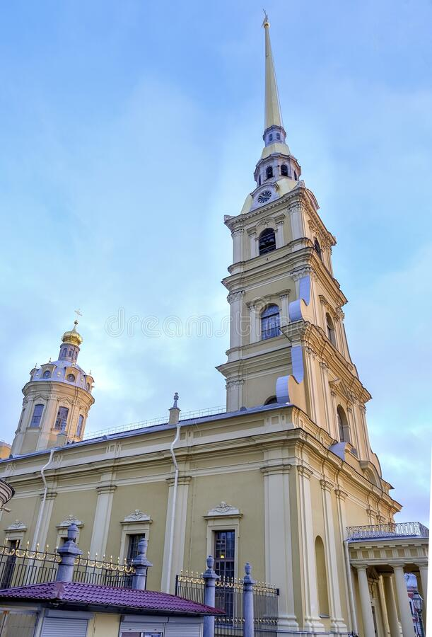 The bell tower of St. Peter`s Basilica in the Peter and Paul fortress. St. Petersburg, Russia. January 11, 2020. Vertical orientation. Selective focus royalty free stock photography