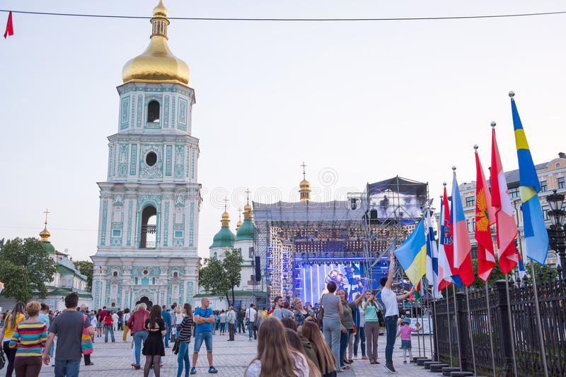 Bell tower of St. Sophia Cathedral, stage and flags of countries. Which Eurovision participants on the Sophia Square in the Kyiv, in Ukraine. 07.05.2017 stock photos