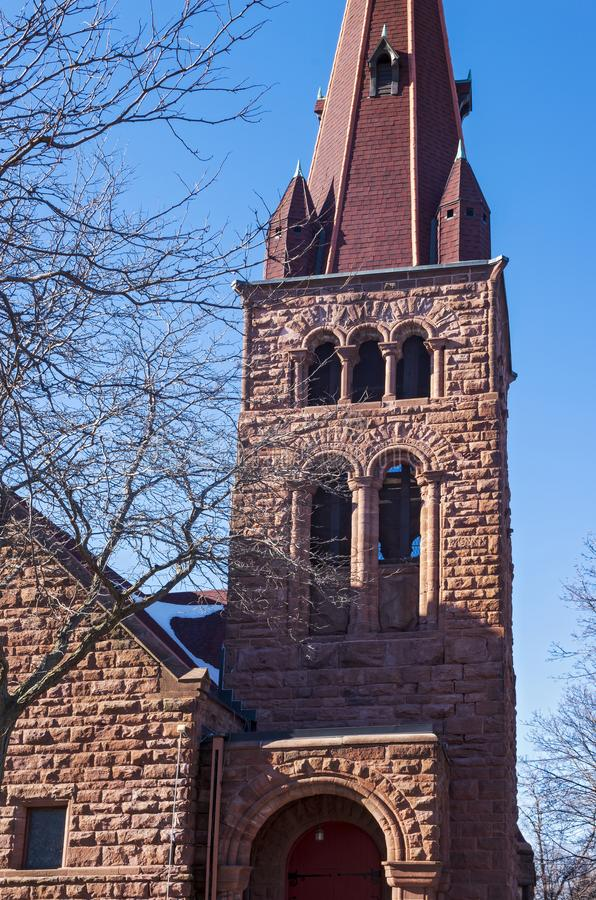 Bell Tower and Steeple Above Church Entrance in Saint Paul. Bell tower and steeple above entrance of landmark church built in richardsonian romanesque style royalty free stock image