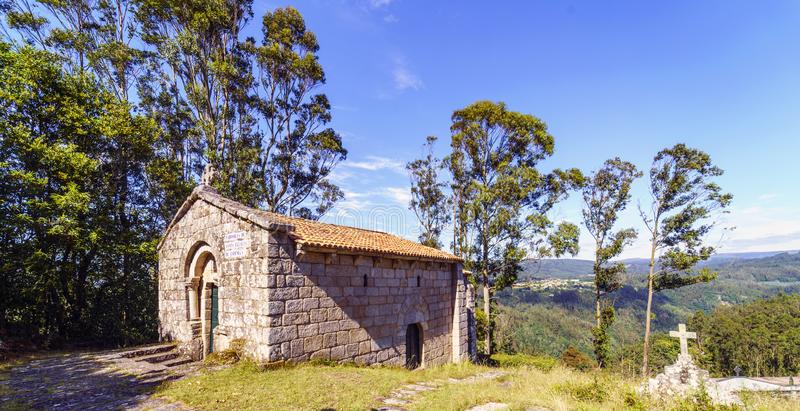 Bell tower and stone cross on the top of the hill called. `La Espenuca` in Galicia Spain.Clear sky with some clouds. Without people stock images