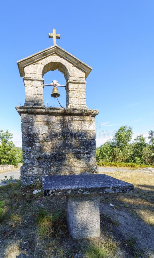 Bell tower and stone cross on the top of the hill called. `La Espenuca` in Galicia Spain.Clear sky with some clouds. Without people stock photo