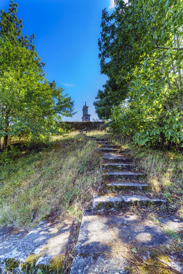 Bell tower and stone cross on the top of the hill called. `La Espenuca` in Galicia Spain.Clear sky with some clouds. Without people stock image