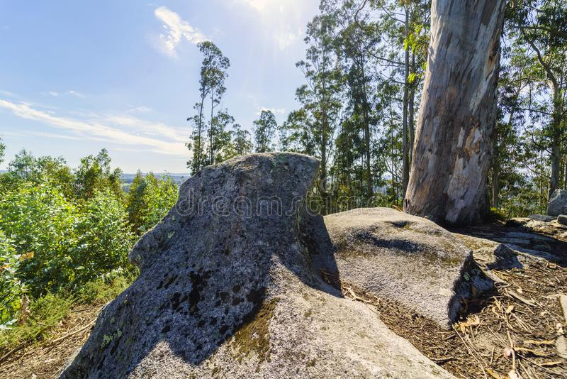 Bell tower and stone cross on the top of the hill called. `La Espenuca` in Galicia Spain.Clear sky with some clouds. Without people royalty free stock photography