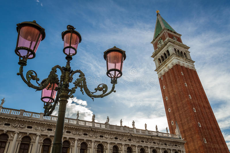 Bell tower and street lamp on St. Mark's Square, Venice royalty free stock image