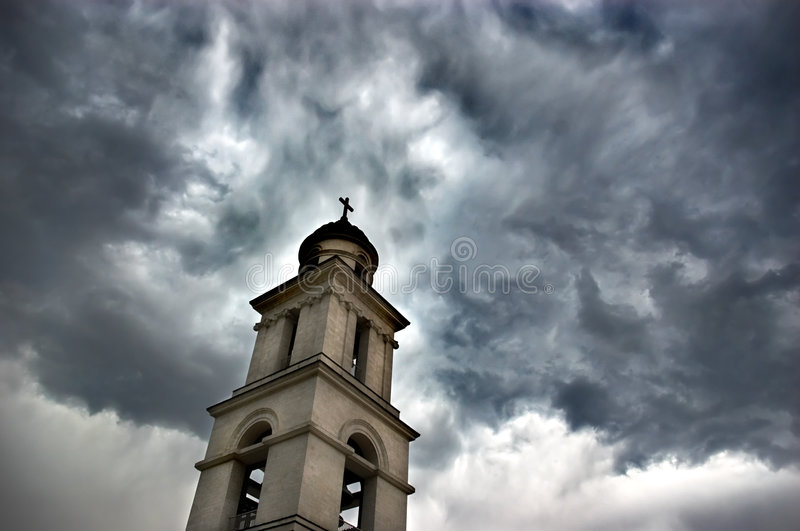 Bell tower under dramatic sky stock photo