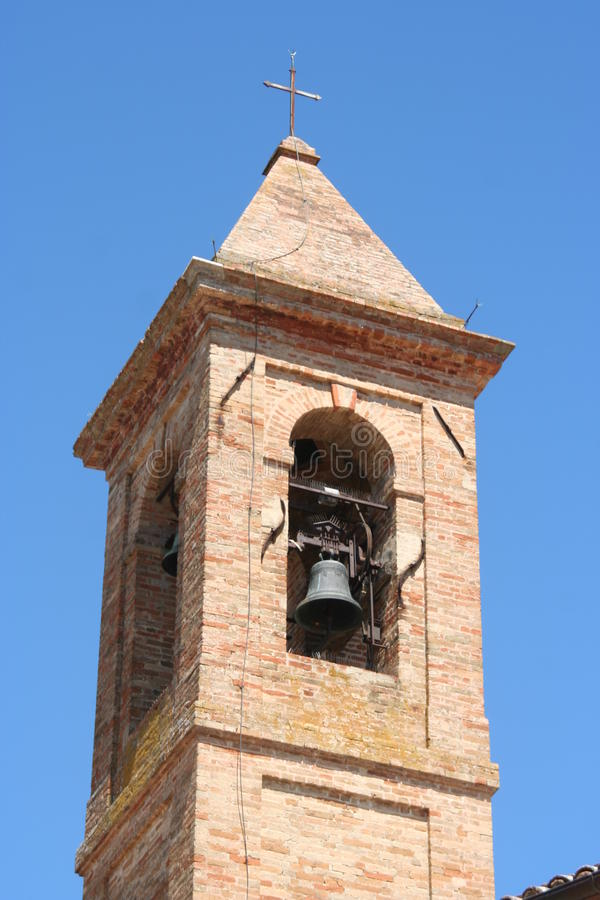 Bell tower in Urbisaglia, Marche, Italy. Bell tower in middle-age fortified town of Urbisaglia in arche, middle Italy stock photo