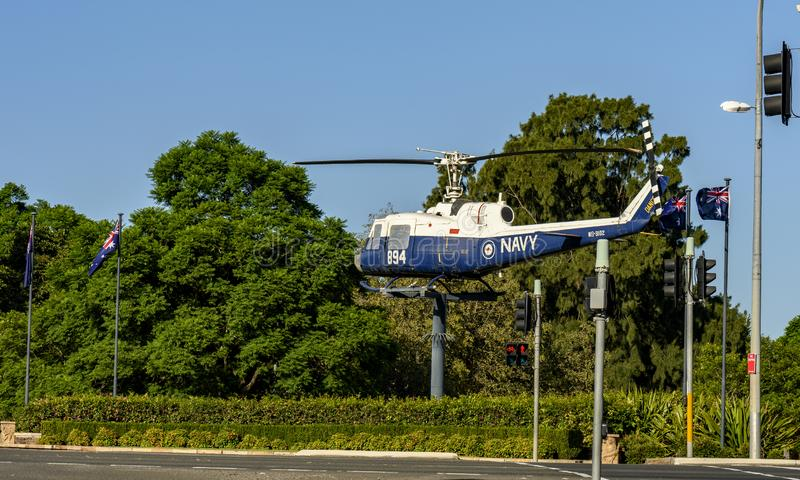 Helicopter Display at entrance to Nowra. The Bell UH-1 Iroquois nicknamed `Huey` is a utility military helicopter powered by a single turboshaft engine. This stock photography