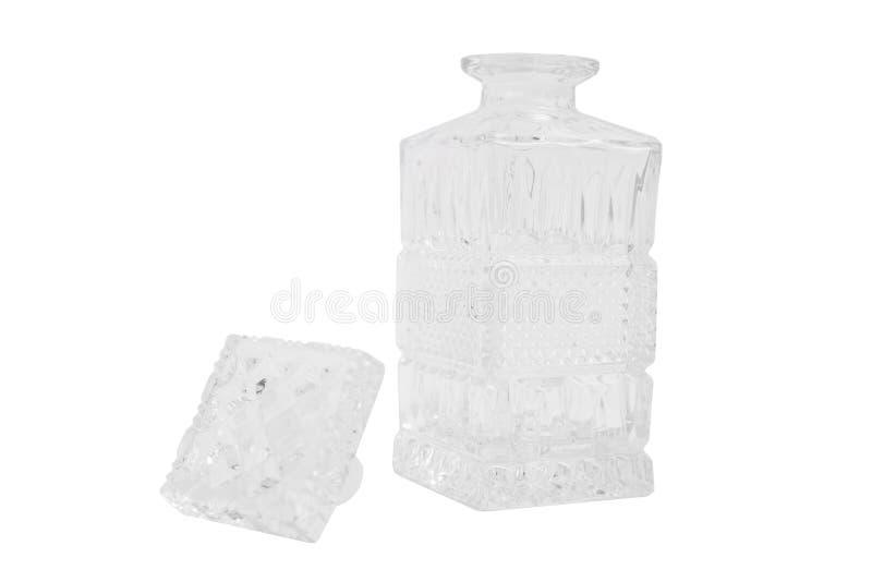 Bella caraffa vuota trasparente di vetro con la spina su fondo isolato immagine stock libera da diritti