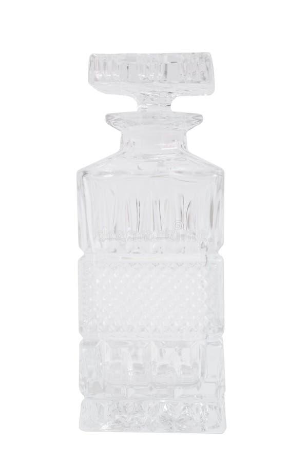Bella caraffa vuota trasparente di vetro con la spina su fondo isolato fotografia stock