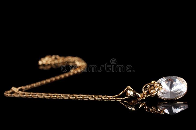 Bella collana dell'oro con la gemma fotografia stock