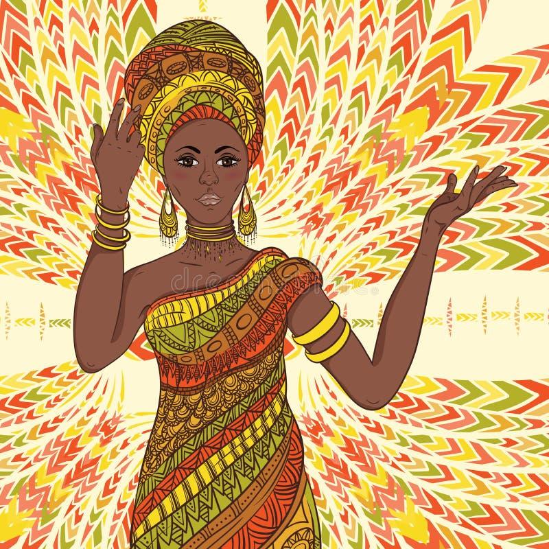 Bella donna africana ballante in turbante e costume tradizionale con l'ornamento geometrico etnico integrale