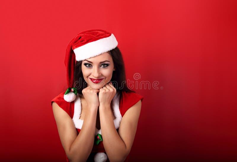 Bella donna casuale ottimista che sorride nel christm del Babbo Natale fotografia stock