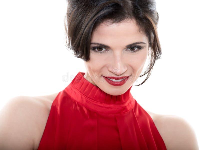 Bella donna caucasica sorridente che guarda giù fotografia stock