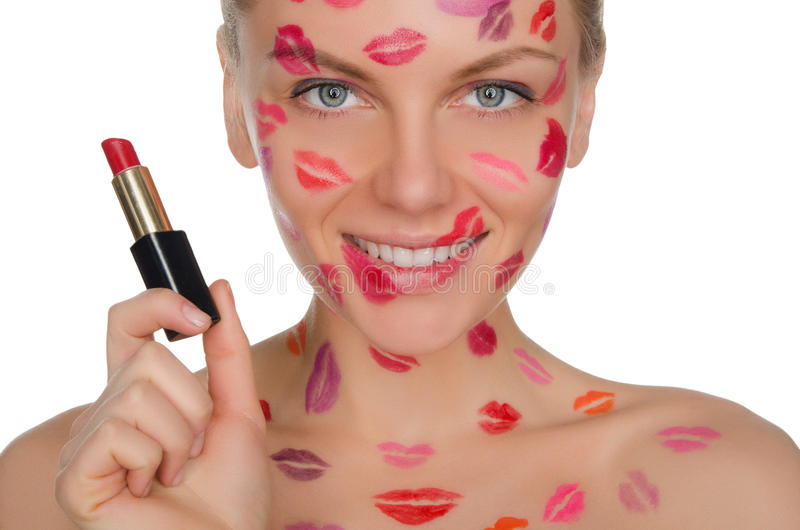 Bella donna con i baci sul fronte e sul rossetto a disposizione immagine stock libera da diritti