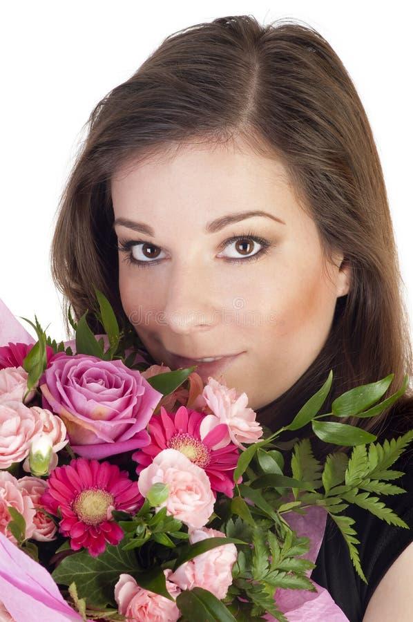 Bella donna con i fiori immagini stock