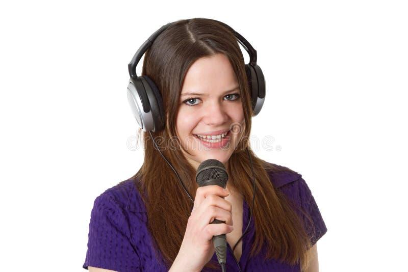 Bella donna con il microfono immagini stock libere da diritti
