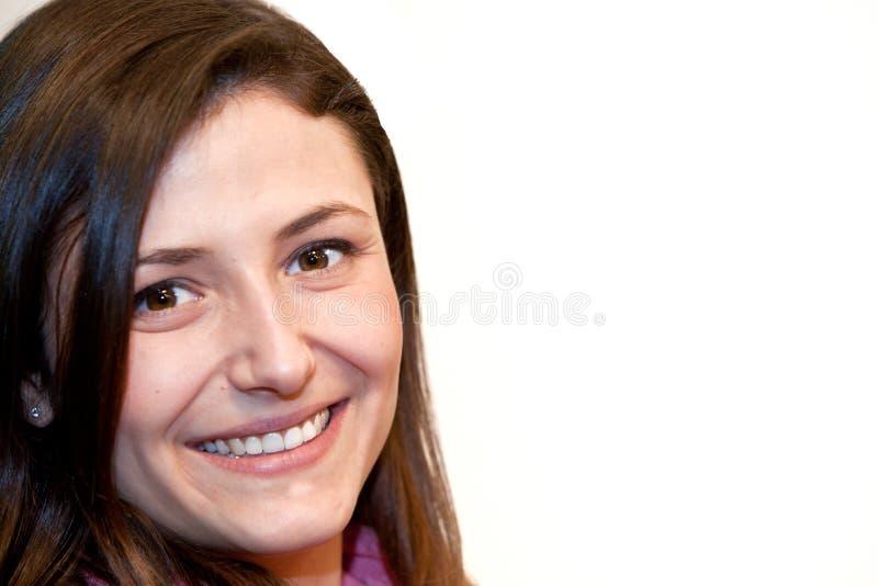 Bella donna con un sorriso radiante fotografie stock libere da diritti