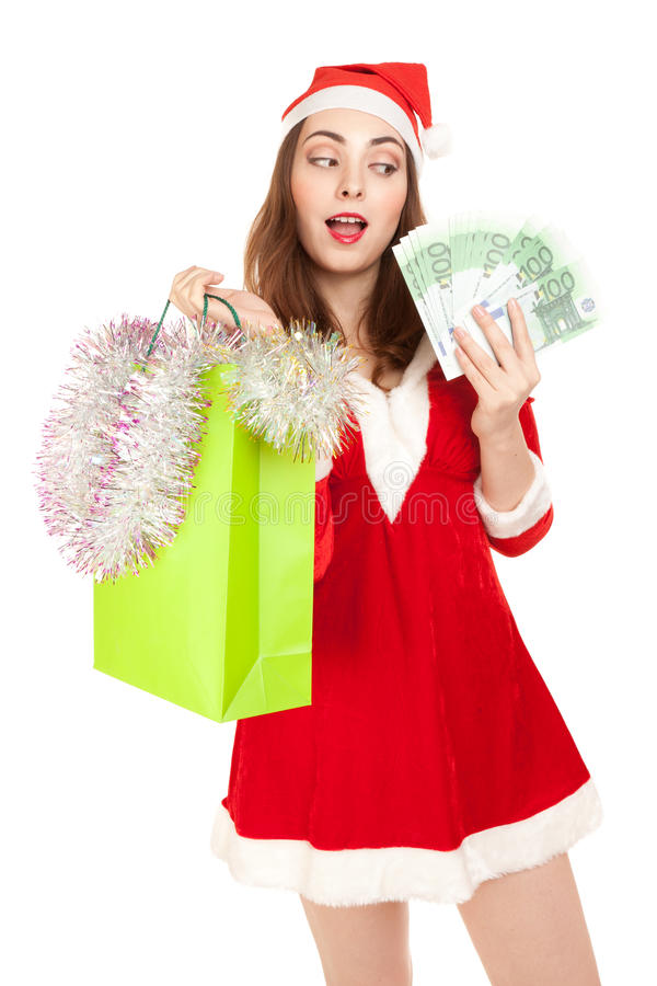 Bella donna in costume del nuovo anno con il sacchetto della spesa e gli euro immagini stock libere da diritti