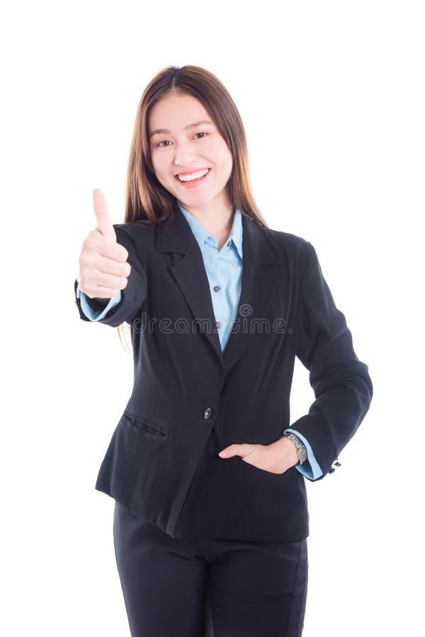 Bella donna di affari in vestito nero che mostra pollice su fotografia stock libera da diritti