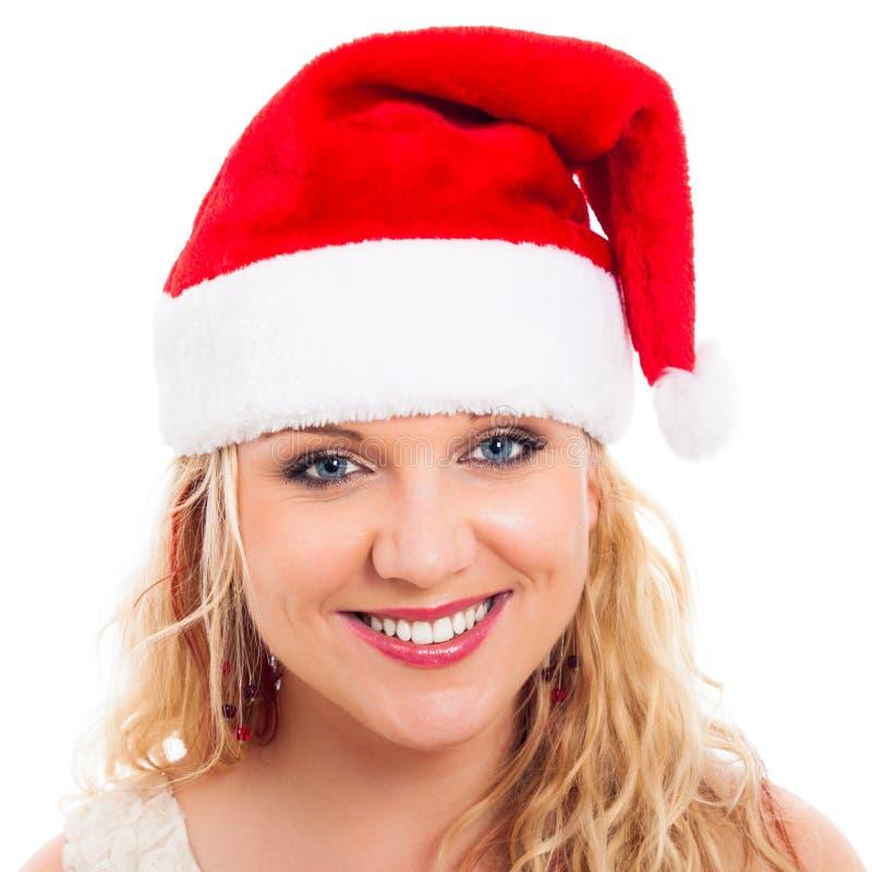 Bella donna felice in cappello della Santa di natale fotografia stock libera da diritti