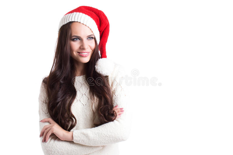 Bella donna sorridente in cappello di Santa immagini stock libere da diritti