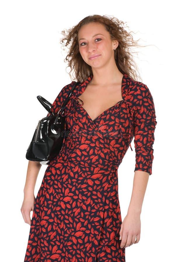 Bella donna in vestito rosso-nero fotografia stock