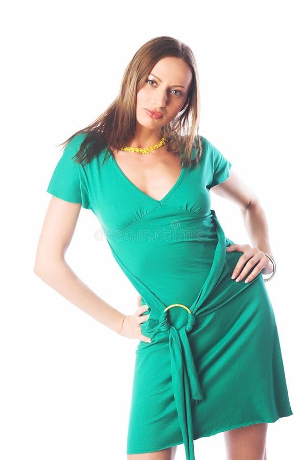 Bella donna in vestito verde fotografia stock